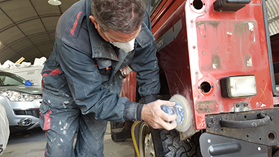 A craftsman from RSV Refinishers Westbury working on a vehicle repair